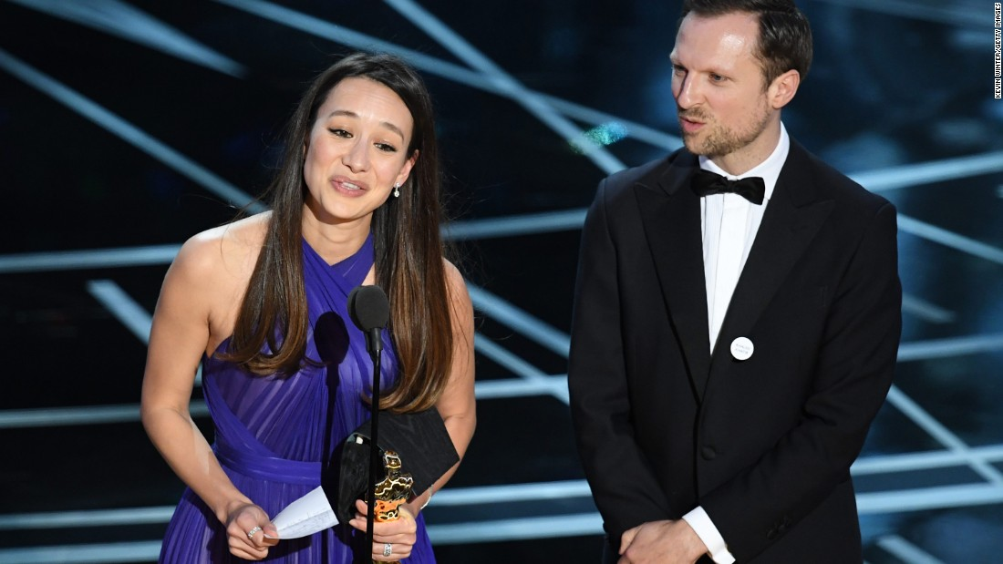 "Producer Joanna Natasegara and director Orlando von Einsiedel accept the Oscar for best documentary (short subject). ""The White Helmets"" is about volunteer rescue workers in Syria."