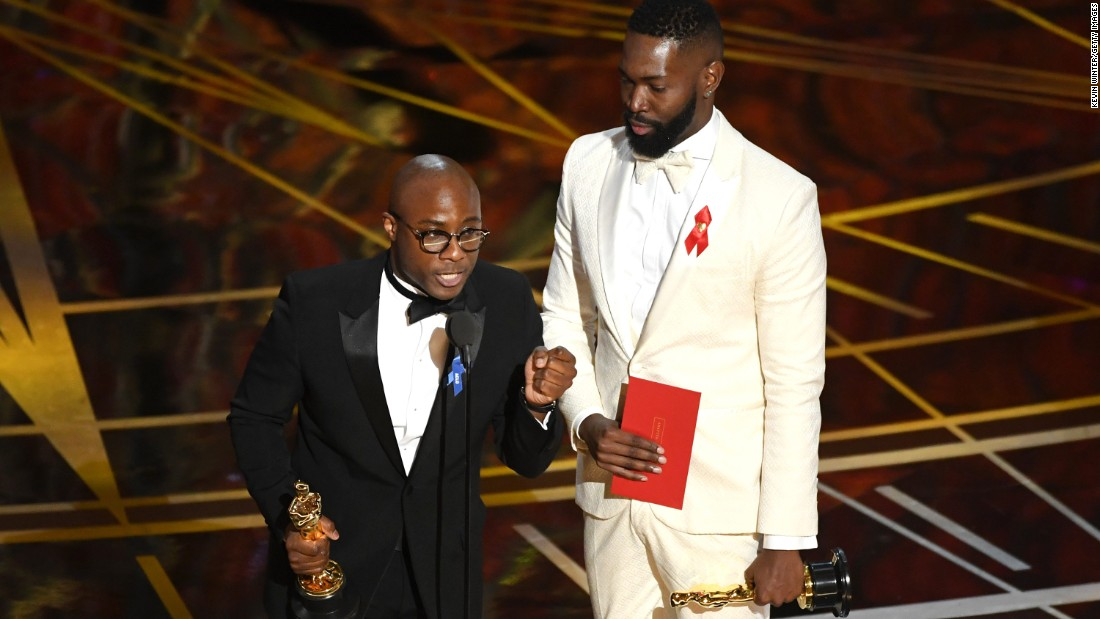 """Moonlight"" director Barry Jenkins, left, and writer Tarell Alvin McCraney accept the Oscar for best adapted screenplay. The film was based on McCraney's play ""In Moonlight Black Boys Look Blue."""