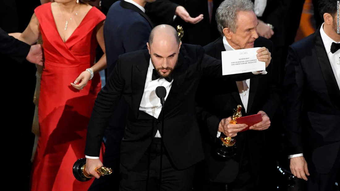 """La La Land"" producer Jordan Horowitz holds up the winner card to the audience, proving that ""Moonlight"" had indeed won. Presenter Warren Beatty, seen behind Horowitz, told the crowd that he was given the wrong envelope."