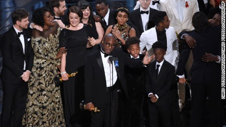 "Barry Jenkins, foreground center, and the cast accept the award for best picture for ""Moonlight"" at the Oscars on Sunday, Feb. 26, 2017, at the Dolby Theatre in Los Angeles. (Photo by Chris Pizzello/Invision/AP)"