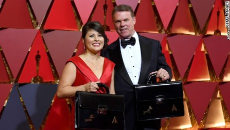 PwC accountants Martha Ruiz and Brian Cullinan carry the briefcases to the Oscar ceremony
