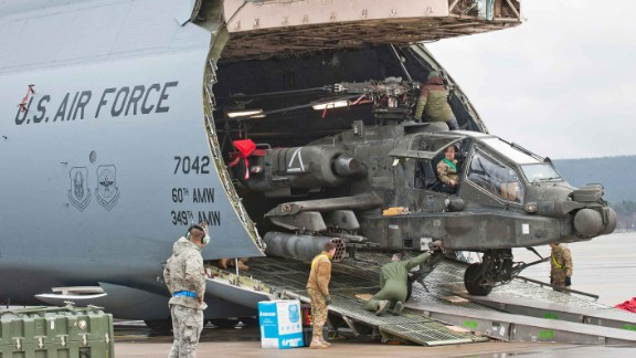 An Apache attack helicopter is being unloaded from a Galaxy C-5 transport plane at the US Air Base in Ramstein, western Germany, on February 22, 2017.