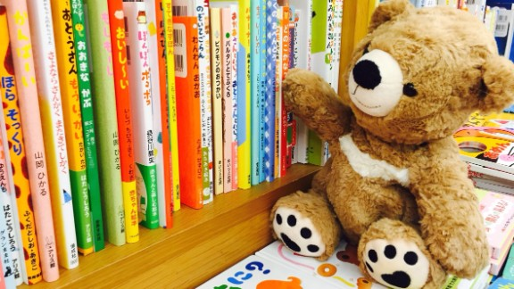 After children leave their stuffed animals at the library for a night, staff members and volunteers snap images of the animals exploring books and acting out scenes from popular stories.
