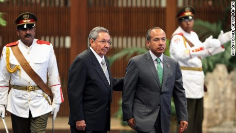 Mexican President Felipe Calderon (R) is received by Cuban President Raul Castro (L) at the Revolution Palace in Havana, on April 11, 2012. Calderon is in Cuba on a 24-hour official visit.    AFP PHOTO/POOL-ALEJANDRO ERNESTO (Photo credit should read ALEJANDRO ERNESTO/AFP/Getty Images)