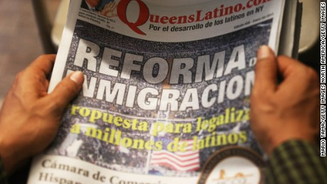 "NEW YORK, NY - JANUARY 29:  A man holds a Spanish language newspaper with an article on immigration reform during a watch party of President Barack Obama's speech on immigration on January 29, 2013 in the Queens borough of New York City. Obama called for immigration reform and a ""pathway to citizenship"" for the nation's 11 million undocumented immigrants.  (Photo by Mario Tama/Getty Images)"