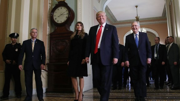 WASHINGTON, DC - NOVEMBER 10:  President-elect Donald Trump, (C), walks with his wife Melania Trump, and Senate Majority Leader Mitch McConnell (R) after a meeting at the U.S. Capitol November 10, 2016 in Washington, DC. Earlier in the day president-elect Trump met with U.S. President Barack Obama at the White House.  (Photo by Mark Wilson/Getty Images)