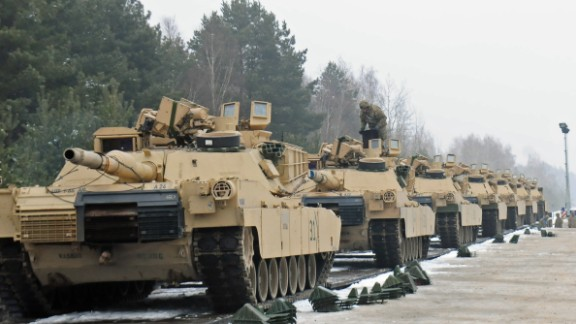 ZAGAN, Poland -- M1A2 Abrams tanks belonging to 1st Battalion, 66th Armored Regiment, 3rd Armored Brigade, 4th Infantry Division have been loaded onto a flatcar railway Jan. 25, 2017. The vehicles will be shipped to Grafenwoehr, Germany to be used by the Soldiers as they conduct training in Eastern Europe as part of Operation Atlantic Resolve. The movement of equipment and troops into and around Europe kicks off what will be a continuous rotation of armored brigades from the United States as part of Operation Atlantic Resolve. The Iron Brigade