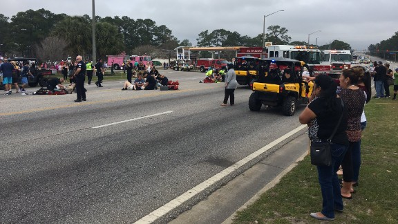 Emergency crews respond to the scene of the parade, which was canceled.