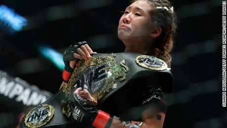 Lee reacts after defeating Mei Yamaguchi in the May 2016 women's atomweight world championship bout during One Championship: Ascent to Power in Singapore.
