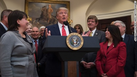 US President Donald Trump (C) speaks before signing the the Waters of the US (WOTUS) executive order, aimed at killing the Obama administration's contentious Clean Water Rule that had drawn the ire of farmers, housing developers and energy companies, at the White House in Washington, DC, February 28, 2017. / AFP / JIM WATSON        (Photo credit should read JIM WATSON/AFP/Getty Images)