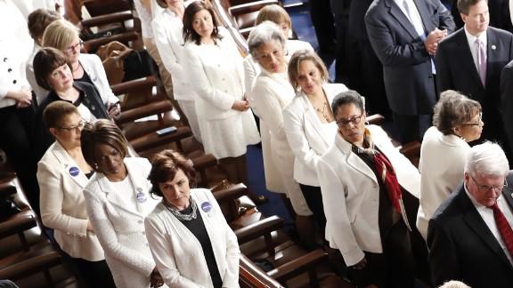 Women Democratic member of Congress, wearing white inn honor of women