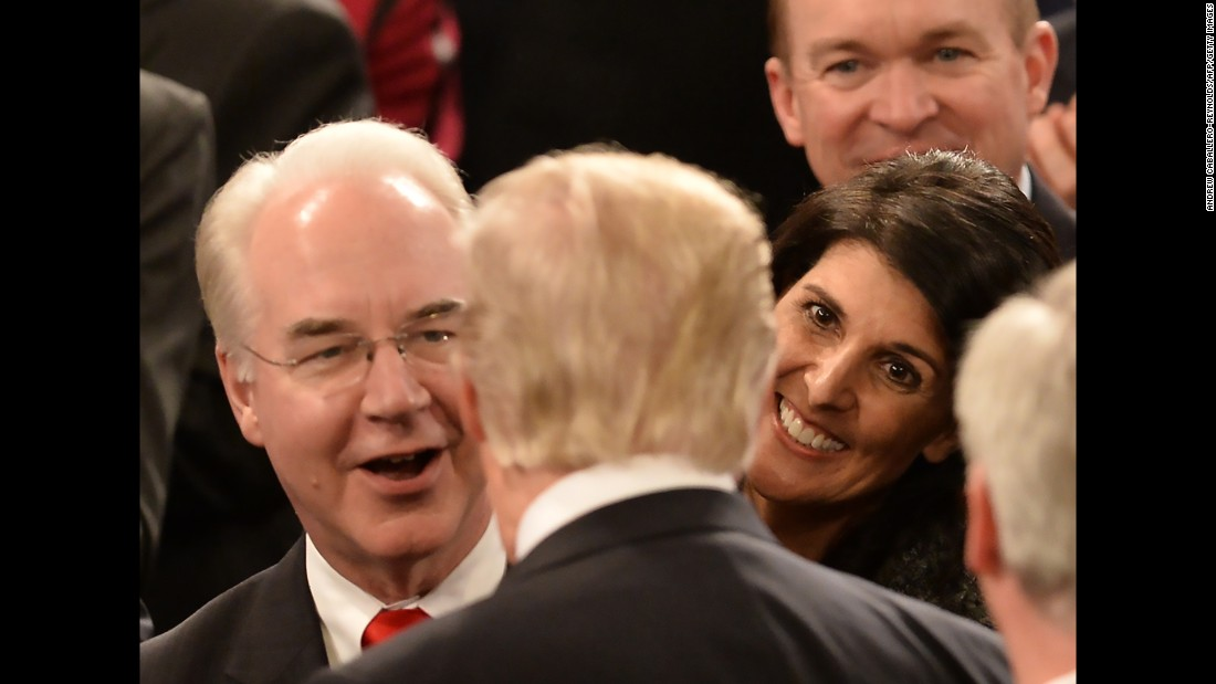 Trump shakes hands on his way through the chamber. Facing the President here are Health and Human Services Secretary Tom Price, left, and UN Ambassador Nikki Haley.