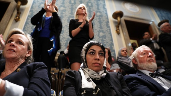 Muslim activist Fauzia Rizvi, a guest of US Rep. Mark Takano, watches Trump