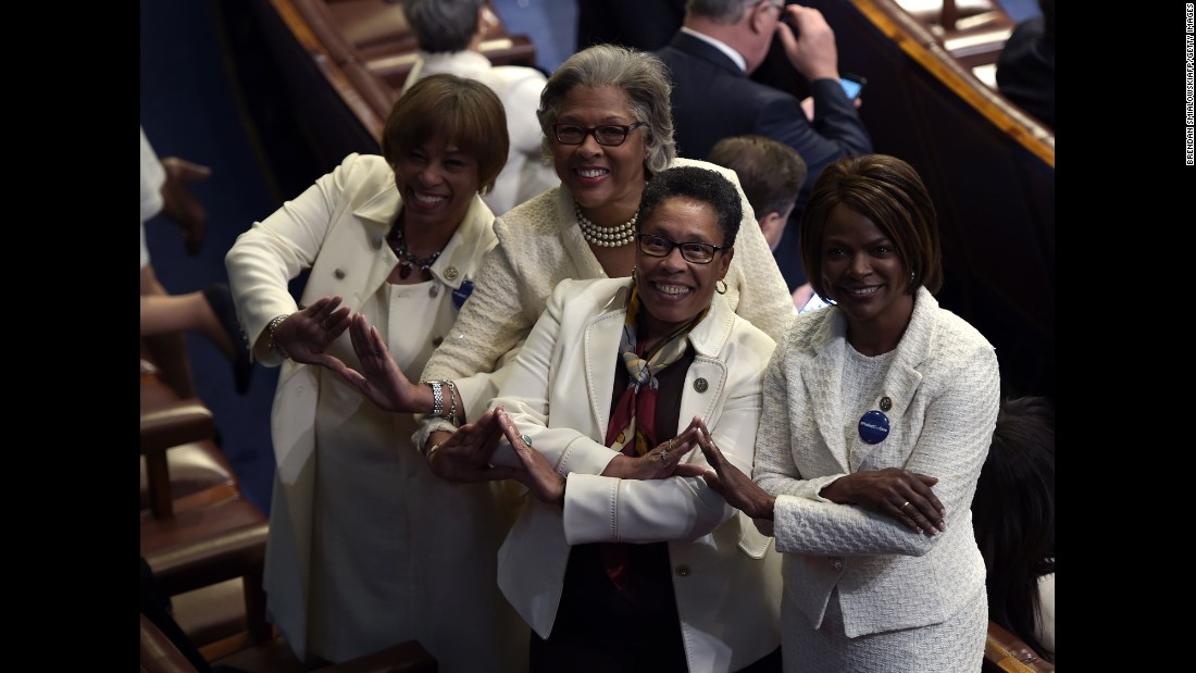 Many Democrats wore white as a nod to the women's suffrage movement. Posing for a photo here are, from left, US Reps. Brenda Lawrence, Joyce Beatty, Marcia Fudge and Val Demings.