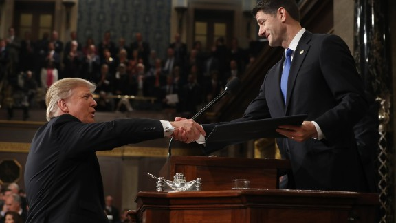 U.S. President Donald J. Trump (L) shakes hands with Speaker of the House Paul Ryan (R) as he arrives to deliver an address to a joint session of the U.S. Congress on February 28, 2017 in the House chamber of the U.S. Capitol in Washington, DC.