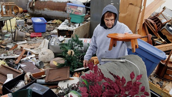 Pat Harber of Perryville, Missouri, looks through the wreckage of her  home.