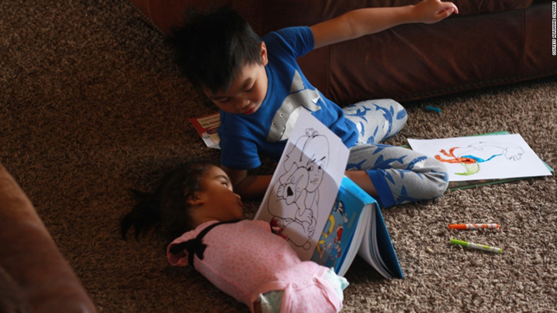 Maria plays with her brother, who was also adopted from the Philippines.
