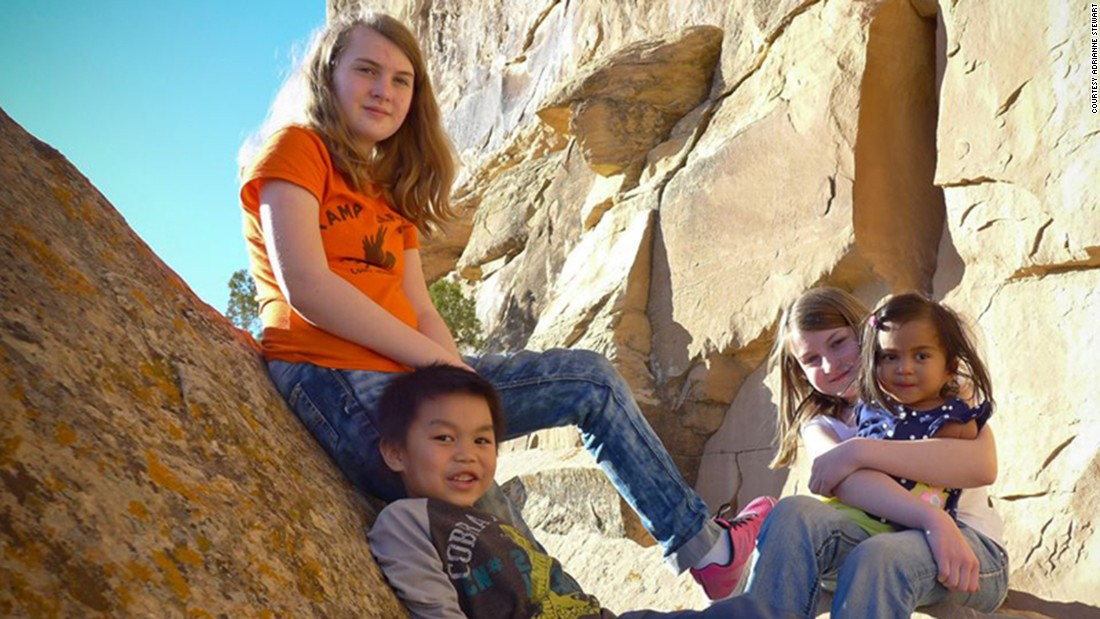 Maria hikes with her adopted sisters and brother.