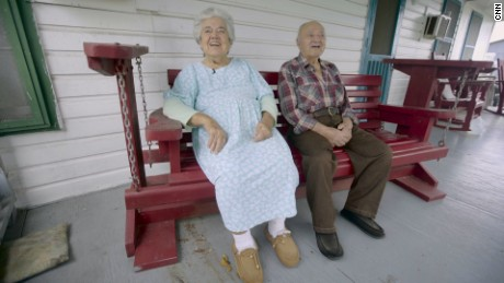 Wenceslaus and Denicia Billiot on the front porch of their home