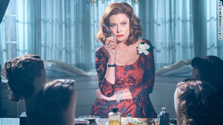 "Susan Sarandon shows off her ""Bette Davis eyes"" with a requisite cigarette."
