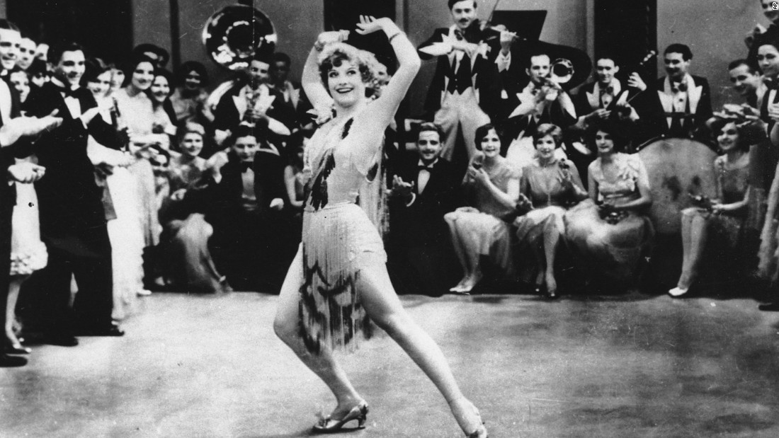 "She claimed to be the same age as Davis (born in 1908), but Crawford was at least four or five years older. She became famous in the silent era, the personification of a flapper in ""Our Dancing Daughters"" (1928). She was already a star at Hollywood's biggest studio, MGM, when Davis arrived from the stage. Crawford established herself as one of the most glamorous and popular actresses of the 1930s, but formulaic films would jeopardize her career."
