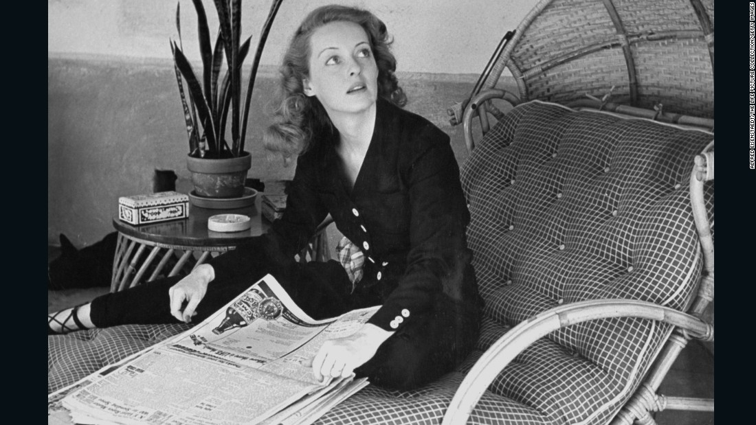 "Davis scans the morning papers during a photo shoot for Life magazine in 1939.  That year, she starred in four movies -- ""Dark Victory,"" ""The Old Maid,"" ""Juarez"" and ""The Private Lives of Elizabeth and Essex."" She became known as ""the first lady of the screen"" and was a top box-office star. ""Juarez"" co-star Brian Aherne would later write in his memoir, ""Surely nobody but a mother could have loved Bette Davis at the height of her career."""