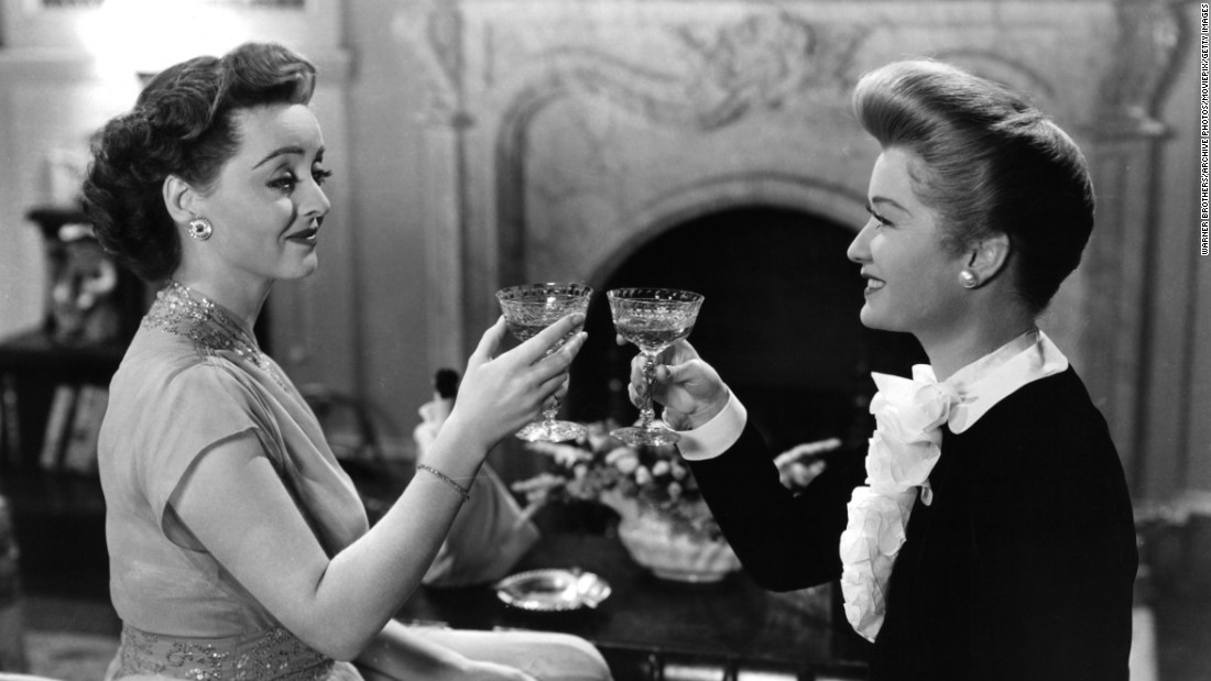"Davis toasts Miriam Hopkins in the final scene of ""Old Acquaintance"" (1943), about two longtime writer friends who are rivals in love and literature. The movie was a follow-up to the stars' 1939 teaming in ""The Old Maid."" Davis had the sympathetic part in both movies, which may have prompted Hopkins to pull out all her scene-stealing tricks. ""Miriam is a perfectly charming woman socially. Working with her is another story,"" Davis said in ""The Lonely Life."""