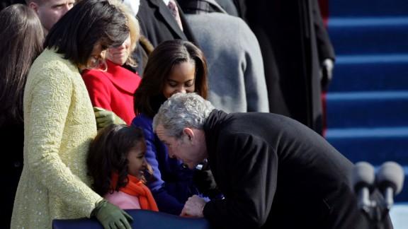 President George W. Bush greets Sasha Obama at the inauguration of Barack Obama on January 20, 2009, in Washington.