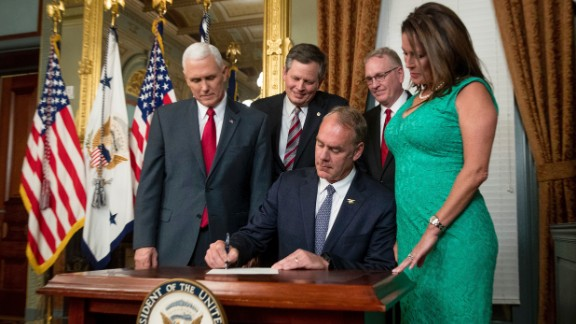 New Interior Secretary Ryan Zinke signs an official document after he was confirmed by the Senate on Wednesday, March 1. The former congressman from Montana was joined by his wife, Lolita, as well as Vice President Mike Pence, US Sen. Steve Daines and Montana Attorney General Tim Fox.