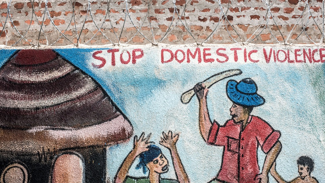 A mural at a clinic in Uganda highlights domestic violence issues. Organizations like RHU and Marie Stopes Uganda say they aim to provide a variety of sexual health and family planning services.