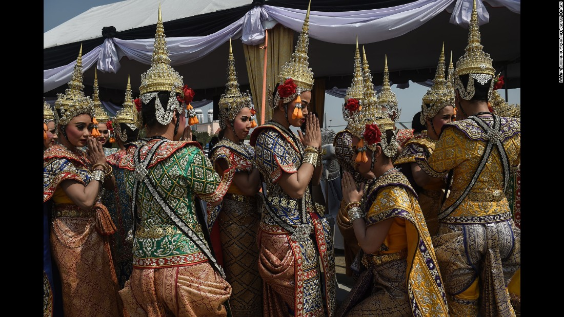 "Traditional Thai dancers wait to perform at a religious ceremony marking the construction of the late king's funeral pyre on Monday, February 27. King Bhumibol Adulyadej, a revered figure who helped unify the nation in his 70-year reign, <a href=""http://www.cnn.com/2016/10/13/asia/thai-king-bhumibol-adulyadej-dies/"" target=""_blank"">died last year</a> at the age of 88."