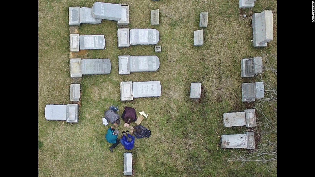 "People gather in prayer amid the toppled headstones at Mount Carmel Cemetery, a Jewish cemetery in Philadelphia, on Monday, February 27. The FBI has joined an investigation to determine whether a hate crime occurred. <a href=""http://www.cnn.com/2017/02/27/us/jewish-cemetery-vandalism-philadelphia/index.html"" target=""_blank"">The vandalism</a> occurred less than a week after a similar incident at a Jewish cemetery near St. Louis and as dozens of Jewish community centers across the United States have received bomb threats."