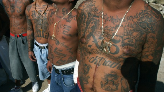 FILE - In this Nov.24, 2005 file photo shows unidentified members of the gang Mara Salvatrucha who are incarcerated in the National Penitentiary of Tamara, in Tegucigalpa, Honduras. The deadliest prison blaze in a century has drawn attention to an unfortunate U.S. export to Central America, street gangs. Prisons in Honduras and elsewhere in Central America are teeming with inmates who belong to gangs that have their roots in Southern California. Refugees of the regions civil wars sowed a new breed of violence on the streets of Los Angeles in the 1980s. (AP Photo/Esteban Felix,File)