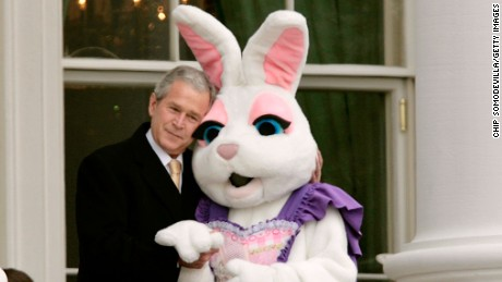 Bush embraces a person dressed as the Easter bunny during the annual Easter Egg Roll on March 24, 2008.