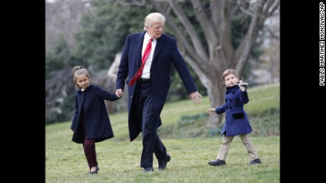 President Donald Trump walks with his grandchildren. Arabella Kushner and Joseph Kushner, holding a model of Marine One, across the South Lawn of the White House in Washington, Friday, March 3, 2017, before boarding Marine One helicopter for the short flight to nearby Andrews Air Force Base, Friday, March 3, 2017. (AP Photo/Pablo Martinez Monsivais)