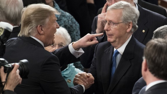 Trump greets Senate Majority Leader Mitch McConnell after delivering his speech to Congress.