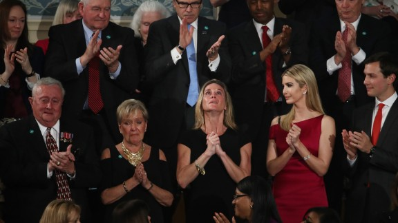 """An emotional Carryn Owens, center, looks up as <a href=""""http://www.cnn.com/2017/02/28/politics/navy-seal-widow-trump-address/"""" target=""""_blank"""">she is applauded during President Trump's address</a> to Congress on Tuesday, February 28. Owens' husband, Navy SEAL William """"Ryan"""" Owens, recently was killed during a mission in Yemen. """"Ryan died as he lived: a warrior and a hero, battling against terrorism and securing our nation,"""" Trump said. The applause lasted over a minute, which Trump said must be a record."""