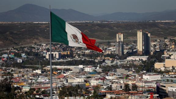 TIJUANA, MEXICO - JANUARY 26:  A large Mexican flag flies over the city on January 26, 2017 in Tijuana, Mexico.  U.S. President Donald Trump announced a proposal to impose a 20 percent tax on all imported goods from Mexico to pay for the border wall between the United States and Mexico. Mexican President Enrique Pea Nieto canceled a planned meeting with President Trump over who would pay for Trump's campaign promise to build a border wall.  (Photo by Justin Sullivan/Getty Images)