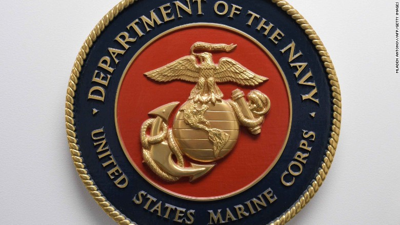The United States Marine Corps emblem hanging on a wall at the Joint Detention Forces Headquarters at Guantanamo Bay US Naval Base, Cuba, April 09, 2014.   AFP PHOTO/MLADEN ANTONOV