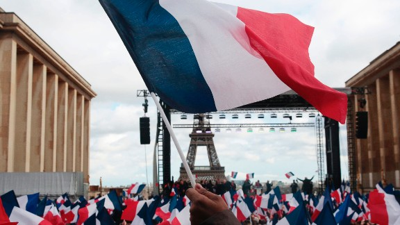 Supporters holding French flags gather for a rally in support of French presidential election candidate for the right-wing Les Republicains (LR) party Francois Fillon at the place du Trocadero, with the Eiffel Tower on the background, in Paris, on March 5, 2017. The former prime minister hopes to keep his election hopes alive with a rally in Paris but he is struggling to regain the initiative after a week in which members of his team deserted him. Their departures followed Fillon's disclosure that he would face charges over claims he gave his British-born wife and two of their children bogus parliamentary jobs. / AFP PHOTO / GEOFFROY VAN DER HASSELT        (Photo credit should read GEOFFROY VAN DER HASSELT/AFP/Getty Images)