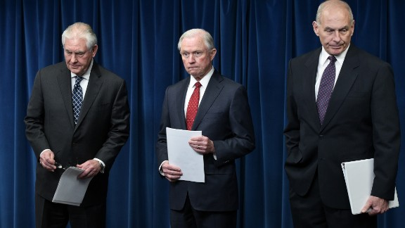 """(L-R) US Secretary of State Rex Tillerson, Attorney General Jeff Sessions, and Homeland Security Secretary John Kelly arrive to deliver remarks on visa travel at the US Customs and Border Protection Press Room in the Reagan Building on March 6, 2017 in Washington, DC. US President Donald Trump signed a revised ban on travelers from six Muslim-majority nations Monday -- one with a reduced scope so Iraqis and permanent US residents are exempt. The White House said Trump signed the order -- which temporarily freezes new visas for Syrians, Iranians, Libyans, Somalis, Yemenis and Sudanese citizens -- behind closed doors """"this morning"""".  / AFP PHOTO / MANDEL NGAN        (Photo credit should read MANDEL NGAN/AFP/Getty Images)"""