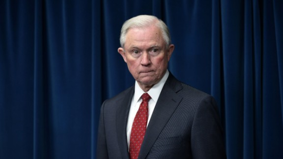 """US Attorney General Jeff Sessions waits for his turn to speak on visa travel at the US Customs and Border Protection Press Room in the Reagan Building on March 6, 2017 in Washington, DC. US President Donald Trump signed a revised ban on travelers from six Muslim-majority nations Monday -- one with a reduced scope so Iraqis and permanent US residents are exempt. The White House said Trump signed the order -- which temporarily freezes new visas for Syrians, Iranians, Libyans, Somalis, Yemenis and Sudanese citizens -- behind closed doors """"this morning"""".  / AFP PHOTO / MANDEL NGAN        (Photo credit should read MANDEL NGAN/AFP/Getty Images)"""