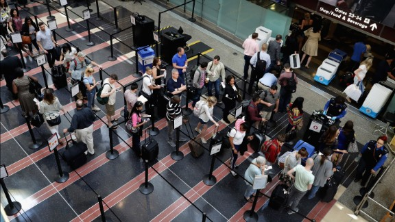Passengers queue up outside a Transportation Security Administration checkpoint at Ronald Reagan National Airport May 27, 2016 in Arlington, Virginia.
