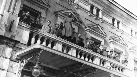 Russian revolutionists stand on the balcony of the Tsar