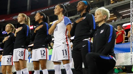 Rapinoe kneels during the US national anthem before a match against the Netherlands in September 2016.