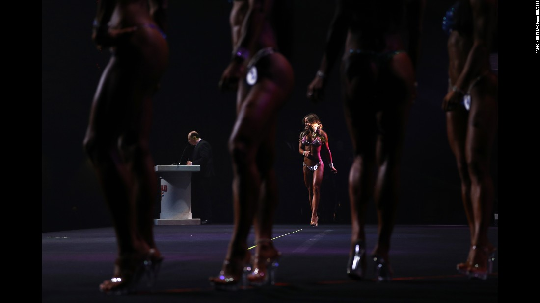 Justine Munro walks on stage during the Arnold Sports Festival, a bodybuilding event in Columbus, Ohio, on Saturday, March 4. She finished sixth in the Bikini International competition.