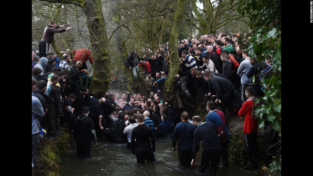 "People tussle in a river Tuesday, February 28, as they take part in the Royal Shrovetide Football match, <a href=""http://www.cnn.com/2013/02/13/europe/gallery/ashbourne-football/index.html"" target=""_blank"">a brutal, rugby-style game</a> that occurs annually in Ashbourne, England. Hundreds of participants try to get a ball into one of two goals positioned 3 miles apart at either end of Ashbourne."