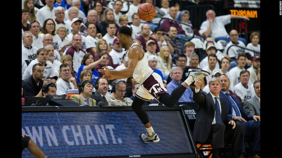 Texas A&M guard J.C. Hampton runs into the scorers' table during a home game against Kentucky on Saturday, March 4.