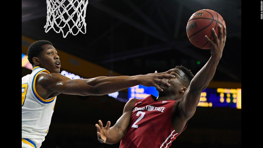 Washington State guard Ike Iroegbu is hit in the face by UCLA's Ike Anigbogu during a Pac-12 basketball game on Saturday, March 4.
