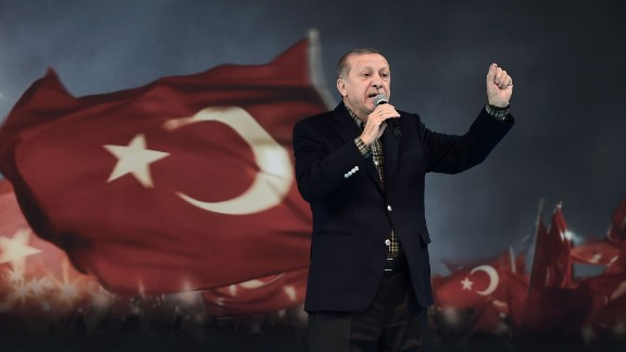 "Turkish President Recep Tayyip Erdogan gestures as he delivers a speech on stage, on March 5, 2017 in Istanbul during a pro-government women meeting. Some 12,000 women filled on March 5 an Istanbul arena in support of a ""Yes"" vote in an April referendum whether to boost Turkish President Recep Tayyip Erdogan"